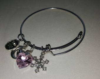 bracelet is silver plated charms and rhinestones