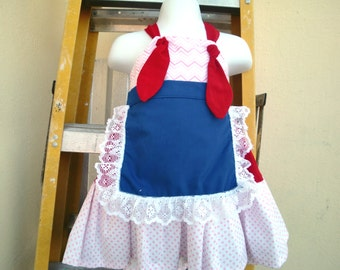AMERICANA KNOT Dresses in Chevron, red and dots with apron in blue