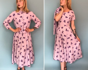 Small 1950s lilac and violet tulip print dress and bolero