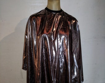 Water resistant chemical and cutting capes