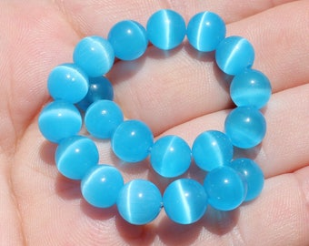 5 ŒIL CAT MEXICAN OPAL BLUE 8 MM ROUND BEADS.
