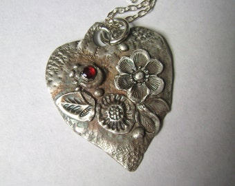 new fine silver heart pendant with garnet