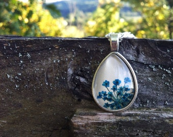 Pressed flower necklace - naturalist gift - nature lovers blue necklace with real pressed flowers - real flower jewelry over beige leather