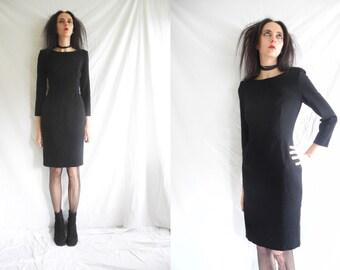 Jil Sander 90's classic fitted minimalist black stretch wool long sleeve dress.