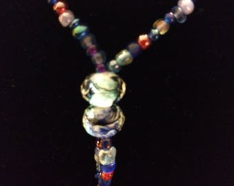Periwinkle lanyard with blue swirl beads