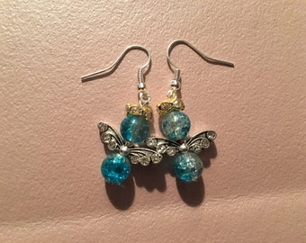 Earrings, dangle, blue angel with silver wings and gold rhinestone halo on sterling silver hooks.