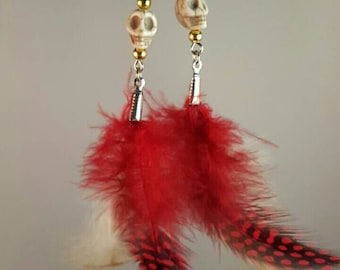 Bohemian style red feather earrings with skull and gold colored beads