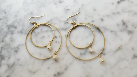 Small moonstone on brass connected circles rings hoops