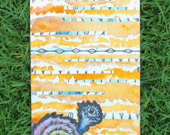Fuzzy Eyeball Monster mixed media with blue and orange pattern