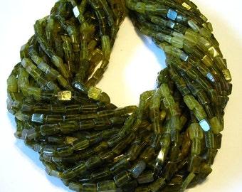 "Grossular green garnet shaded rectangular beads full 14"" stand."