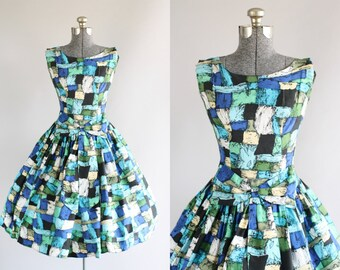 Vintage 1950s Dress / 50s Party Dress / Turquoise and Black Abstract Print Dress w/ Bow XS