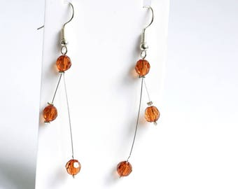 Earrings on wire cable with Brown acrylic beads