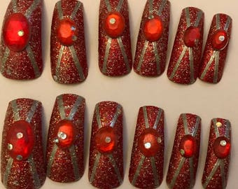 Long claw style red fancy dress or drag nails.