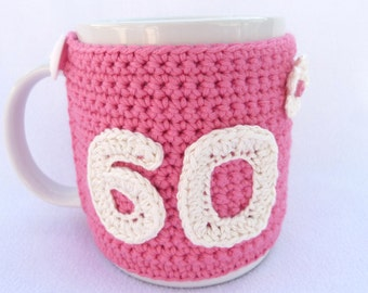 Handmade, 60th Birthday pink crochet mug cosy. Homewares, birthday gift, accessories, 60th birthday gift, crocheted, gift for her, cup cosy