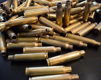 BULLETS - 12 brass shells, bullet casings, spent shells, large shells