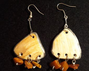 Earrings made of sea shells and amber