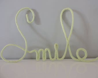 """smile"" word in lime green knitting 5 letters"