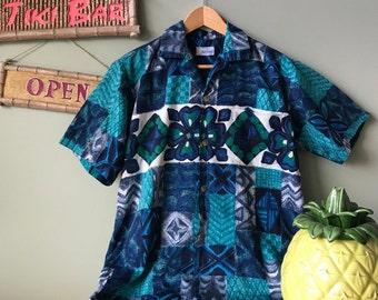 "Wonderful vintage made in Hawaii ""Andrade Honolulu"" Hawaiian Aloha shirt from the 1960's.  Incredible Kamehameha metal buttons!"