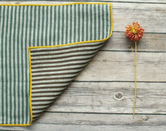 striped 100% linen placemat two sided in gray and off white and brown and ivory edges with gold edging