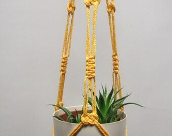 Hanging planter. Macrame plant hanger. Hanging flowerpot holder.