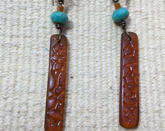 """Earrings, brown sea glass with turquoise color bead, gold tone, 2 1/2"""" total length."""