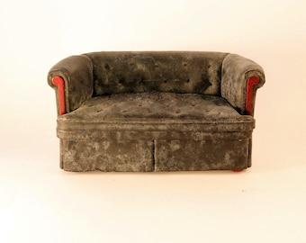 Chesterfield sofa, worn down