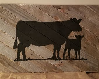 Cow calf painting on old barn wood.