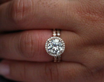Forever Brilliant Moissanite Engagement Ring and Wedding Band Set in 14k Rose Gold with Round 9mm and Diamond Halo