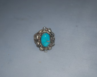 Sterling silver ring size 4 with turquoise.