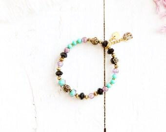 Aladdin bracelet, elastic wire, gold, turquoise, black, mauve and purple beads, charm, Arabian Nights, for women