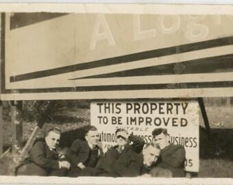 Vintage photo 1913 Men Lying Underneath Property Improved Sign