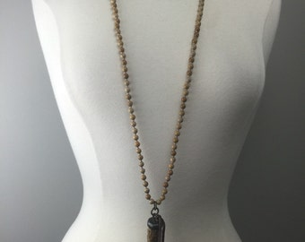 Hand knotted beaded necklace with soldered horn