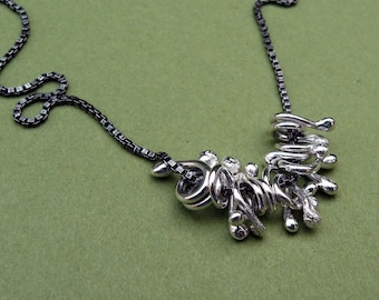 Sterling Silver Fringe - HooBeDoos on an oxidized chain