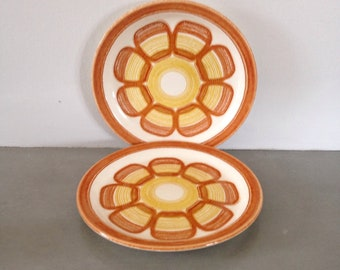 pair of small vintage tiki plates from the 60s