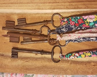 Large vintage key hung on Liberty fabric