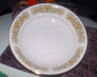Vintage (1980s) Towne House Japan Daffodil pattern 3709 vegetable serving bowl. Yellow flowers, urns, green scrolls, gold edge.