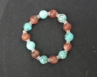 Turquoise magnesite and gold stone bracelet