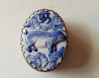 Porcelain topped silver round Chinese themed  box, dog?
