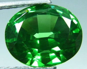 Tsavorite, Flawless Green Tsavorite of  3.5  carats, 10.3 mm by 8.2 mm by 5.9 mm, oval brilliant faceted, Cultured Tsavorite gemstone
