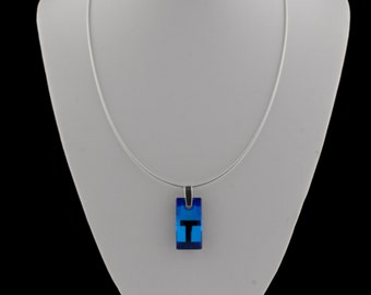Swarovski blue pendant suspended from a sterling silver omega snake chain with extension packaged in an organza bag & gift box