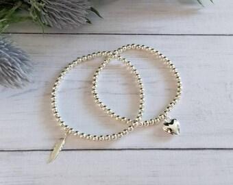 Silver Feather Bracelet, Silver Heart Bracelet, Feather Jewellery, Stretch Bracelets, Beaded Bracelets, Stacking Bracelets, Bracelet Set