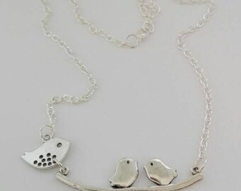 Necklace with silver-colored birds
