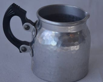 """eb1934 N.C. Joseph Stratford on Avon England Metal Creamer Pebbled Holds About 1 Cup and is about 3"""" tall."""