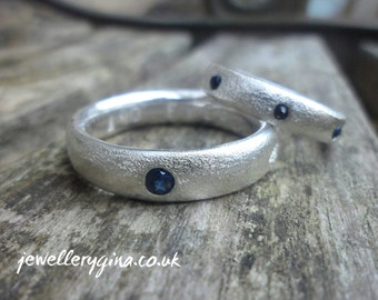 His and hers (or hers and hers) personalised wedding bands in frosted silver. Matching  wedding rings.