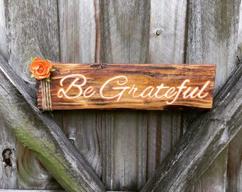 "Wooden ""Be Grateful"" sign"