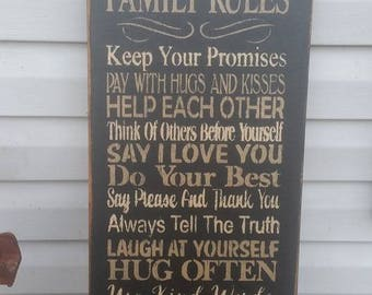 Primitive Sign Family Rules Keep your Promise Pay with Hugs and Kisses Help each other Think of others before yourself Say I Love You