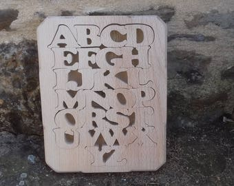 Alphabet puzzle made of solid wood with box