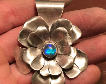Fabricated sterling flower pendant with 1 carat LighteningRidgeOpal