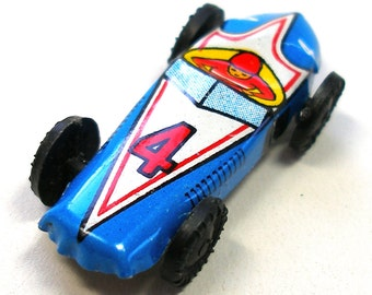 60s Mini tin toy race car in blue, #4 from Japan. Vintage fun.
