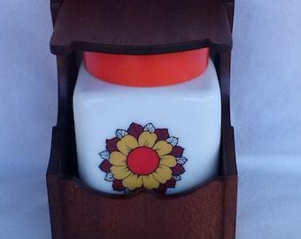 Vintage storage jar with wooden holder